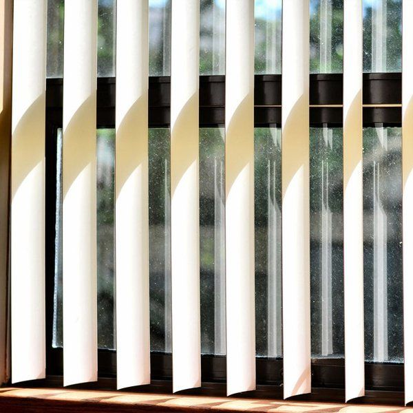 beige vertical blinds in front of a window