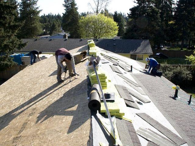 Men installing shingles
