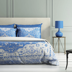 blue and cream coloured pillows