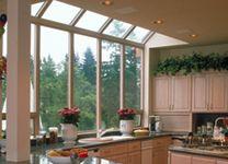 Beautiful modern kitchen with large bay windows