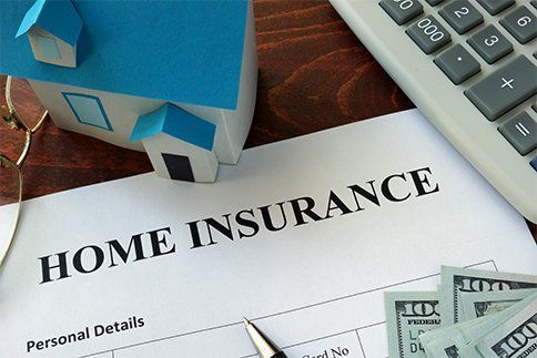 Home insurance form and dollars on the table in Waynesboro