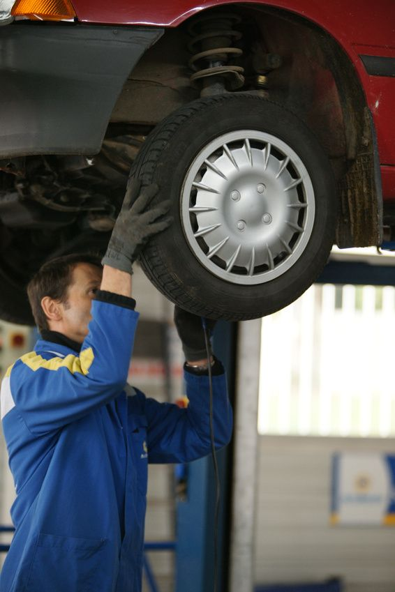 Mechanic giving service to a car