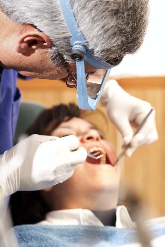 Dentist providing emergency dental checkup services