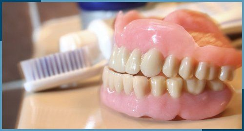 dentures and brush