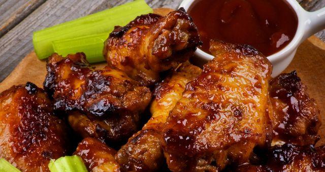 Cincinnati's best chicken wings with sauce in a cup