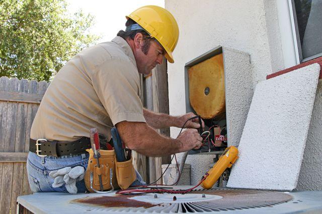 Man repairing AC