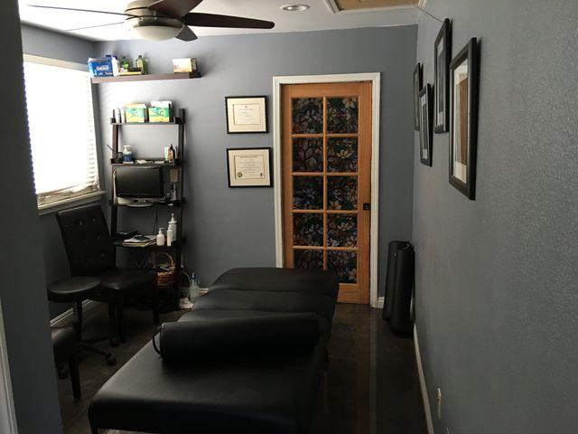 Massage therapist massaging a leg