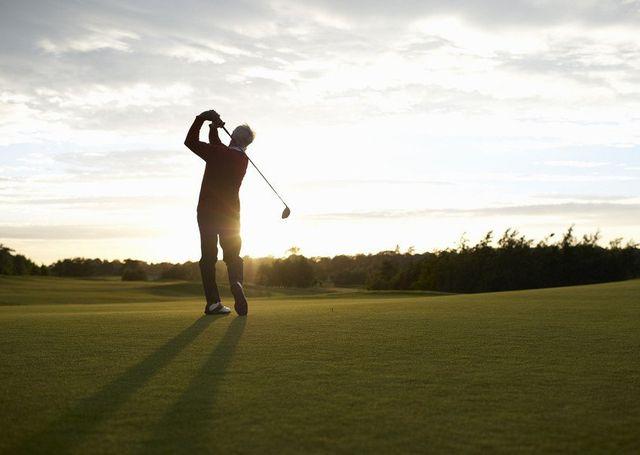 A golfer on a sunlit course