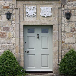 Pale grey front door of Newton Hall grade II listed building