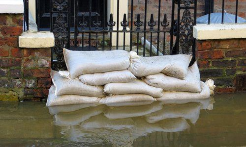sandbags used to prevent water entering a house gate