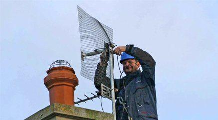 A man repairing an aerial