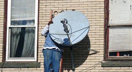 A satellite dish being installed