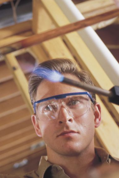 Plumber repairs a gas fitting in Show Low, AZ and surrounding areas