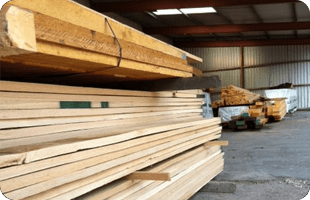timber beams stacked up on pallet