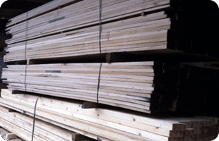 timber beams stacked up on pallets