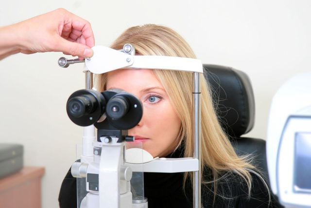 Woman getting checked for contact lenses in Honolulu, HI