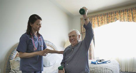 health care expert taking care of an old man