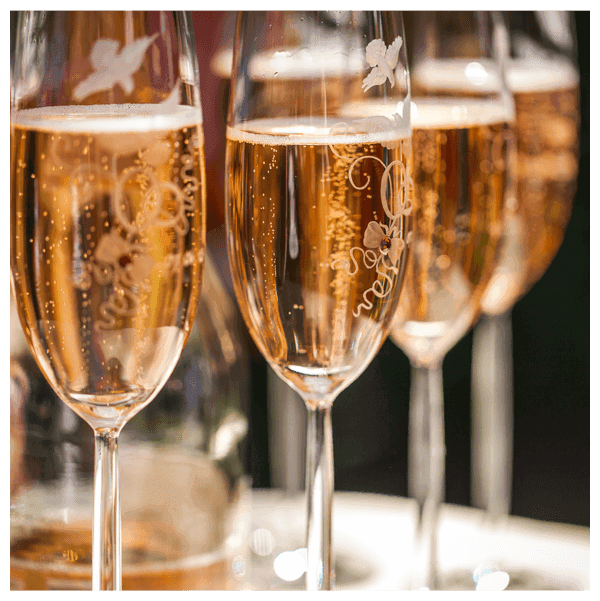 Embellished glasses of champagne