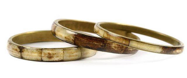 three bronze bracelets