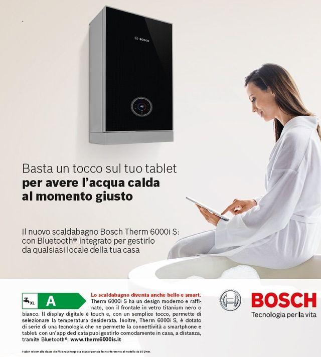 una brochure di una caldaia della marca Bosch e una donna che usa un tablet