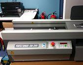 Perfect binding machine in Colour Inc print shop