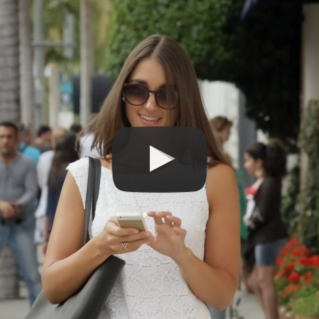 iCape introduction video - image of girl using mobile phone to find salon with iCape