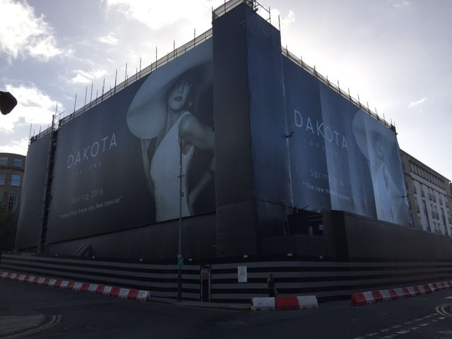 Scaffolding with advertising banner