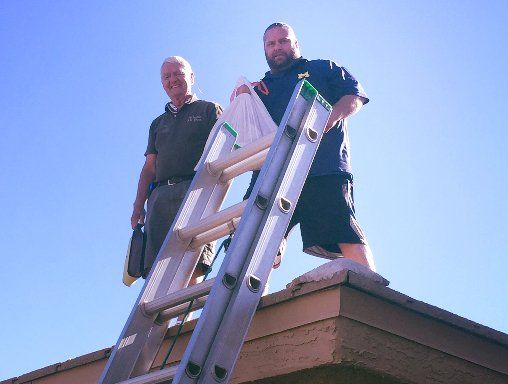 John and Scott on the roof doing a dryer vent cleaning