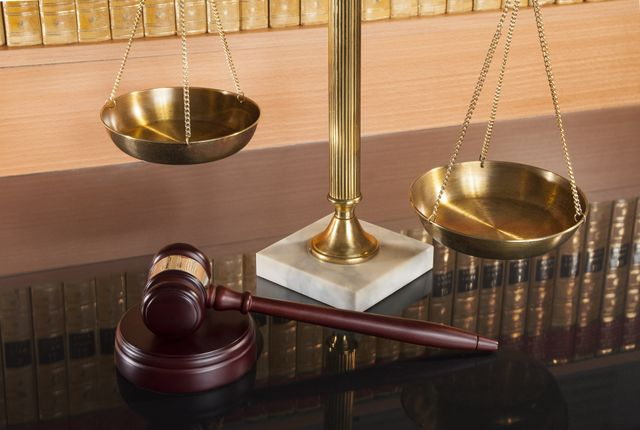 Scale and gavel on a glass table