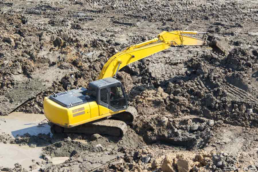 excavator working in mud