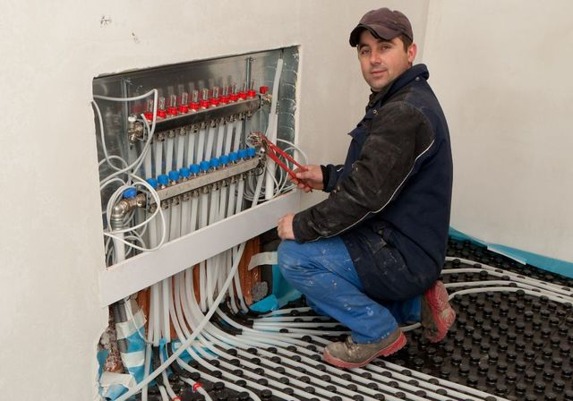 man installing cables during furnace service in Wisconsin Rapids, WI
