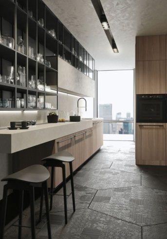 vista cucina con tavolo di vetro