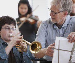 A boy playing cornet