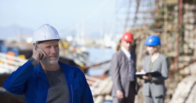 Contractor calling for scaffolding services on an Auckland job site