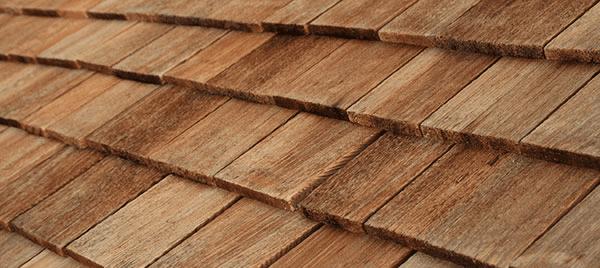 Diagonal detail of brown wood roof shingles in St. Peters
