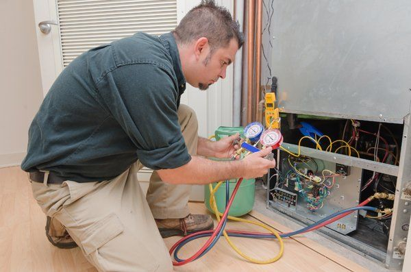 Specialist checking the air conditioner