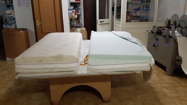 tow mattresses in a bed
