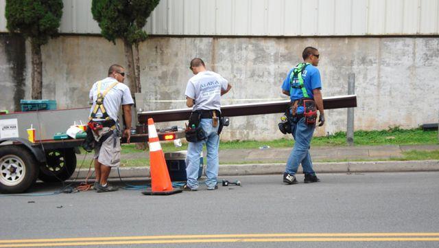 Man installing gutters in Haleiwa, HI