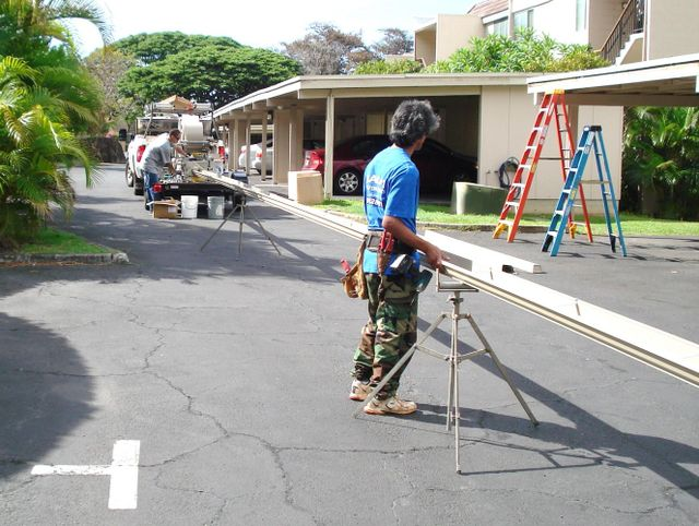 Alaka'i Raingutters & Supplies employees working on downspouts in Oahu.