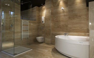 A large stylish bathroom with a corner bath and shower