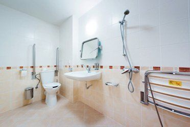 A large, wet room style bathroom