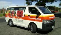 Van with printed signage in Otago