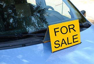 Used car with For Sale sign
