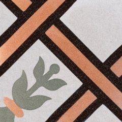 una piastrella di color bianco, marrone e arancione con disegni a righe