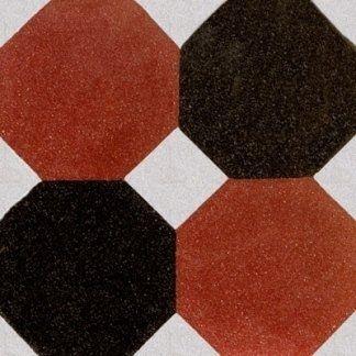 una piastrella di color bianco, arancione e marrone con i disegni a esagone