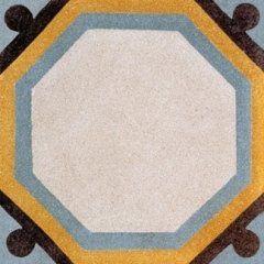 una piastrella a disegni esagonali di color bianco con i bordi di color giallo, marrone e azzurro