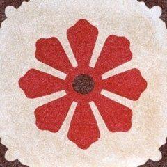 una piastrella con disegni a fiore di color rosso