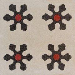delle piastrelle con dei disegni di fiocchi di neve di color nero e rosso