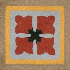 una piastrella a disegni di fiori di color rosso