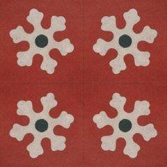 delle piastrelle di color rosso con dei disegni di fiocchi di neve di color bianco
